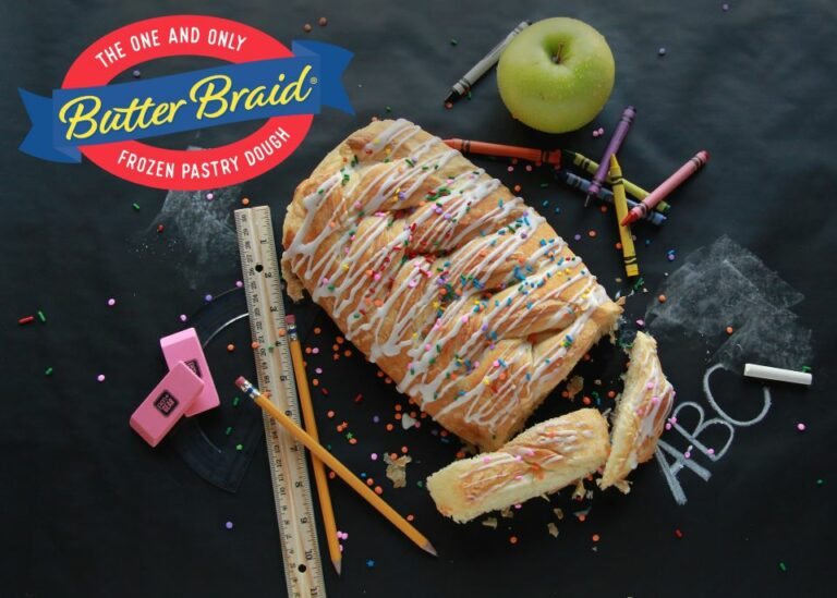 Butter braid pastry on blackboard with school supplies